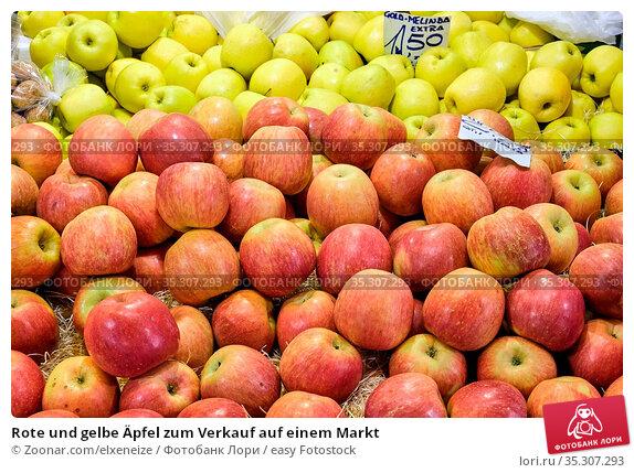 Rote und gelbe Äpfel zum Verkauf auf einem Markt. Стоковое фото, фотограф Zoonar.com/elxeneize / easy Fotostock / Фотобанк Лори