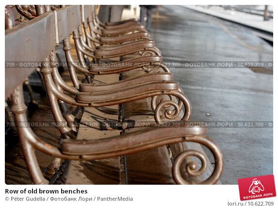 Row of old brown benches. Стоковое фото, фотограф Péter Gudella / PantherMedia / Фотобанк Лори
