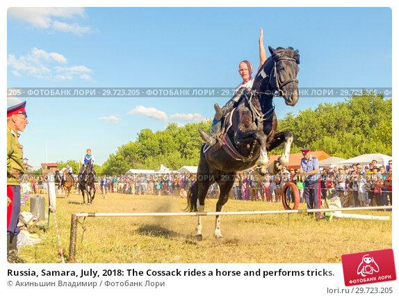 Купить «Russia, Samara, July, 2018: The Cossack rides a horse and performs tricks.», фото № 29723205, снято 29 июля 2018 г. (c) Акиньшин Владимир / Фотобанк Лори