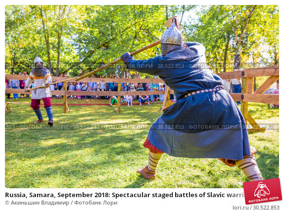 Купить «Russia, Samara, September 2018: Spectacular staged battles of Slavic warriors and knights at the festival in Zagorodny Park.», фото № 30522853, снято 16 сентября 2018 г. (c) Акиньшин Владимир / Фотобанк Лори