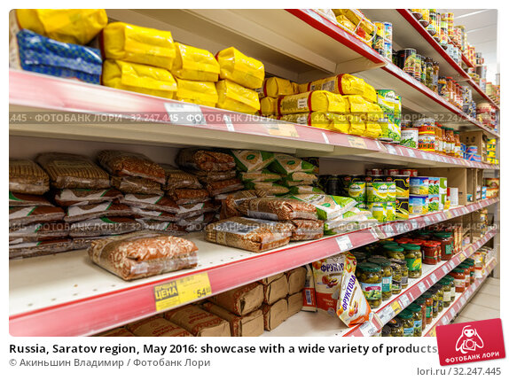 Купить «Russia, Saratov region, May 2016: showcase with a wide variety of products, food and drinks in a large village shop. Text in Russian: fructose.», фото № 32247445, снято 7 мая 2016 г. (c) Акиньшин Владимир / Фотобанк Лори