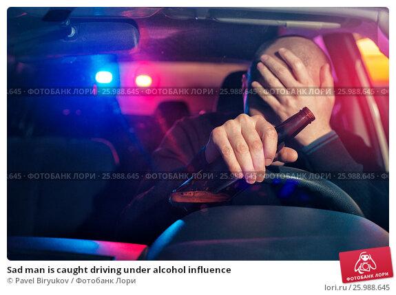 Sad man is caught driving under alcohol influence. Стоковое фото, фотограф Pavel Biryukov / Фотобанк Лори