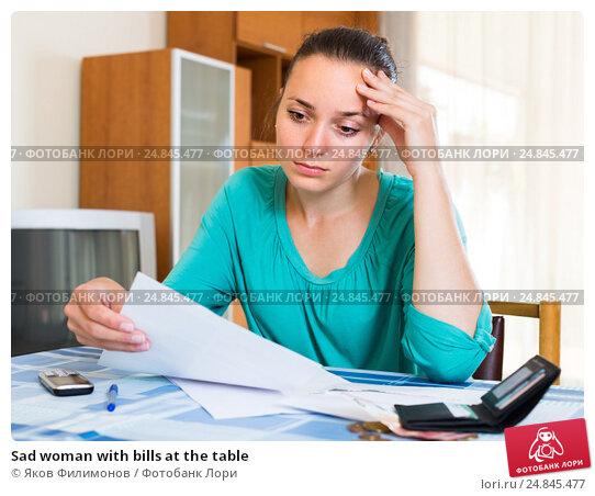 Купить «Sad woman with bills at the table», фото № 24845477, снято 21 августа 2018 г. (c) Яков Филимонов / Фотобанк Лори