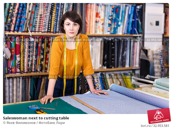 Saleswoman next to cutting table. Стоковое фото, фотограф Яков Филимонов / Фотобанк Лори