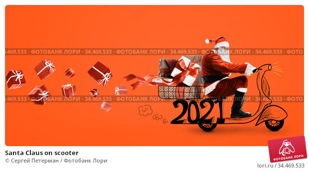 Santa Claus on scooter. Стоковое фото, фотограф Сергей Петерман / Фотобанк Лори