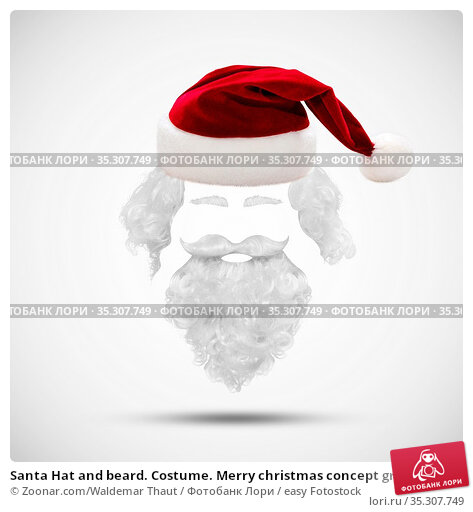 Santa Hat and beard. Costume. Merry christmas concept greeting card. Стоковое фото, фотограф Zoonar.com/Waldemar Thaut / easy Fotostock / Фотобанк Лори