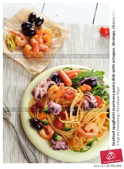 Купить «Seafood spaghetti marinara pasta dish with octopus, shrimps, cherry tomatoes and olives», фото № 28500689, снято 22 апреля 2019 г. (c) Ingram Publishing / Фотобанк Лори