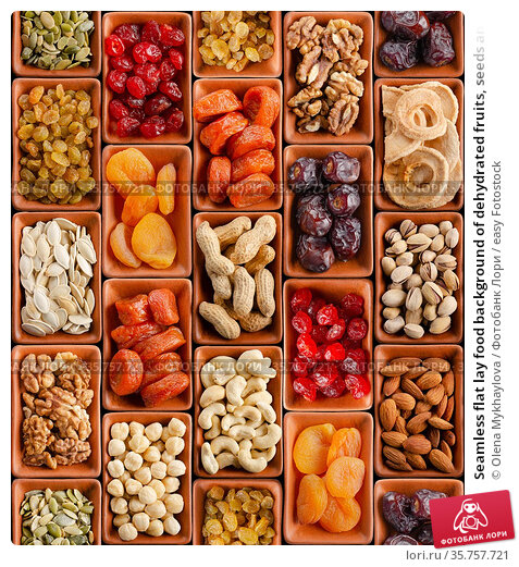 Seamless flat lay food background of dehydrated fruits, seeds and... Стоковое фото, фотограф Olena Mykhaylova / easy Fotostock / Фотобанк Лори