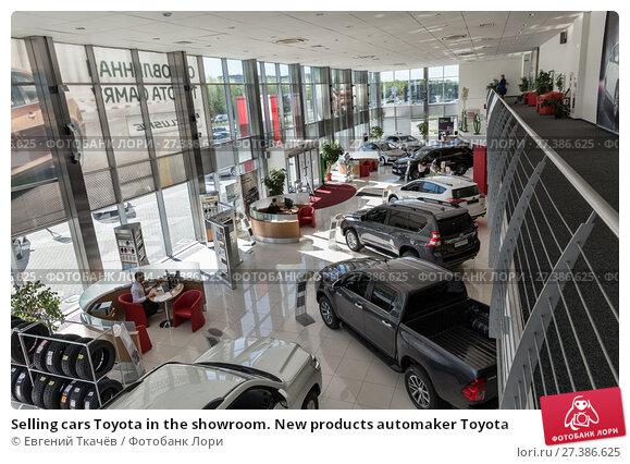 Купить «Selling cars Toyota in the showroom. New products automaker Toyota», фото № 27386625, снято 25 мая 2017 г. (c) Евгений Ткачёв / Фотобанк Лори