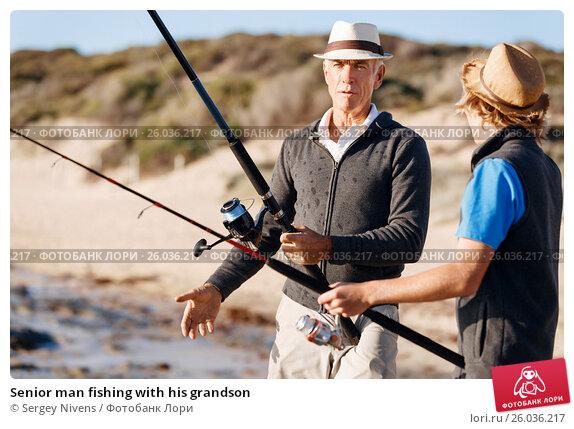 Senior man fishing with his grandson, фото № 26036217, снято 15 апреля 2015 г. (c) Sergey Nivens / Фотобанк Лори