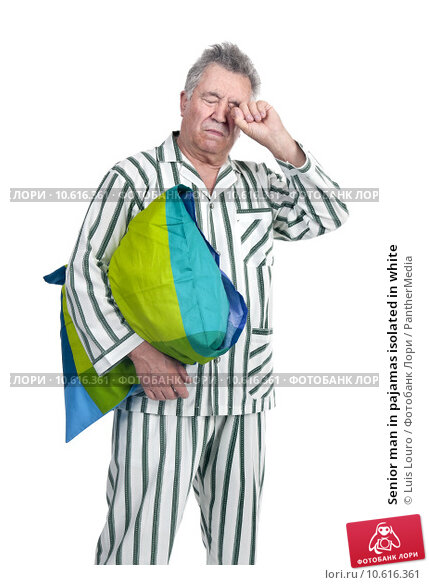 Senior man in pajamas isolated in white. Стоковое фото, фотограф Luis Louro / PantherMedia / Фотобанк Лори