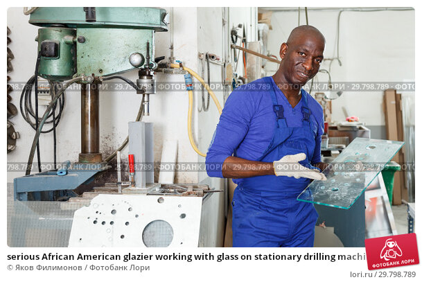 Купить «serious African American glazier working with glass on stationary drilling machine», фото № 29798789, снято 16 мая 2018 г. (c) Яков Филимонов / Фотобанк Лори
