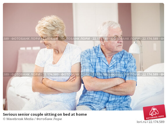 Купить «Serious senior couple sitting on bed at home», фото № 22174589, снято 9 ноября 2015 г. (c) Wavebreak Media / Фотобанк Лори