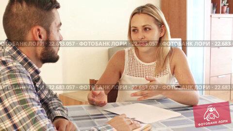 Купить «Serious spouses discussing bills and banking statement at home», видеоролик № 22683057, снято 21 октября 2015 г. (c) Яков Филимонов / Фотобанк Лори