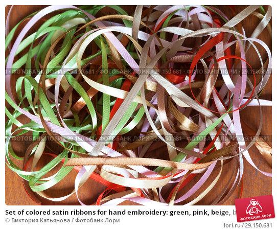 Купить «Set of colored satin ribbons for hand embroidery: green, pink, beige, brown and red on a wooden table», фото № 29150681, снято 27 сентября 2018 г. (c) Виктория Катьянова / Фотобанк Лори