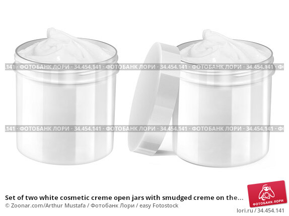 Set of two white cosmetic creme open jars with smudged creme on the... Стоковое фото, фотограф Zoonar.com/Arthur Mustafa / easy Fotostock / Фотобанк Лори