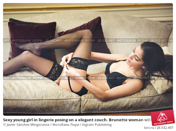 Купить «Sexy young girl in lingerie posing on a elegant couch. Brunette woman with black underwear in her bedroom», фото № 28532497, снято 10 февраля 2016 г. (c) Ingram Publishing / Фотобанк Лори