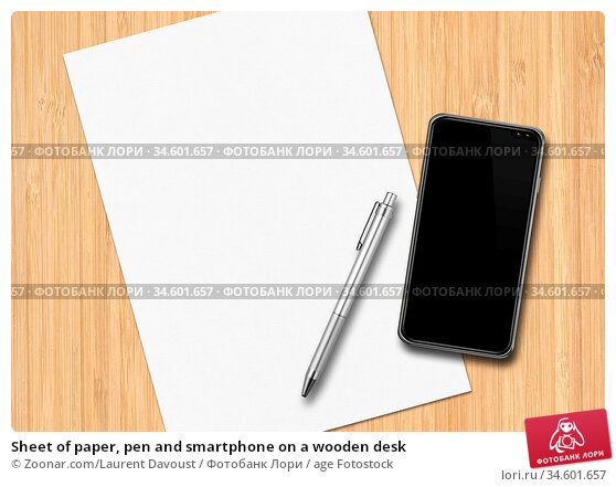Sheet of paper, pen and smartphone on a wooden desk. Стоковое фото, фотограф Zoonar.com/Laurent Davoust / age Fotostock / Фотобанк Лори