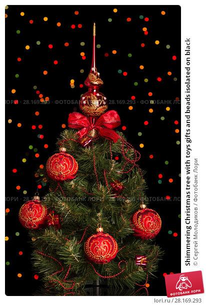 Купить «Shimmering Christmas tree with toys gifts and beads isolated on black», фото № 28169293, снято 19 июня 2017 г. (c) Сергей Молодиков / Фотобанк Лори