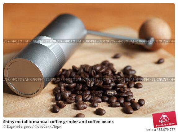 Купить «Shiny metallic manual coffee grinder and coffee beans», фото № 33079757, снято 8 февраля 2020 г. (c) EugeneSergeev / Фотобанк Лори