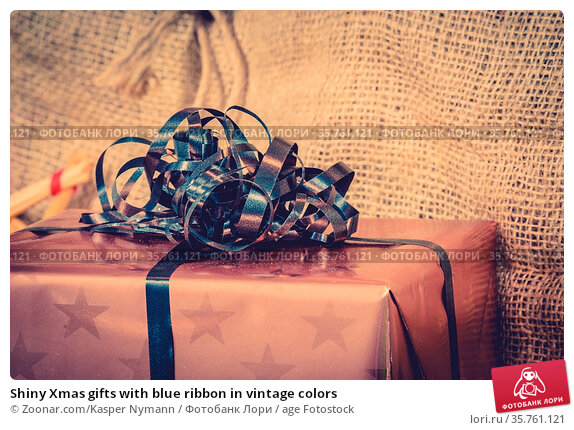 Shiny Xmas gifts with blue ribbon in vintage colors. Стоковое фото, фотограф Zoonar.com/Kasper Nymann / age Fotostock / Фотобанк Лори