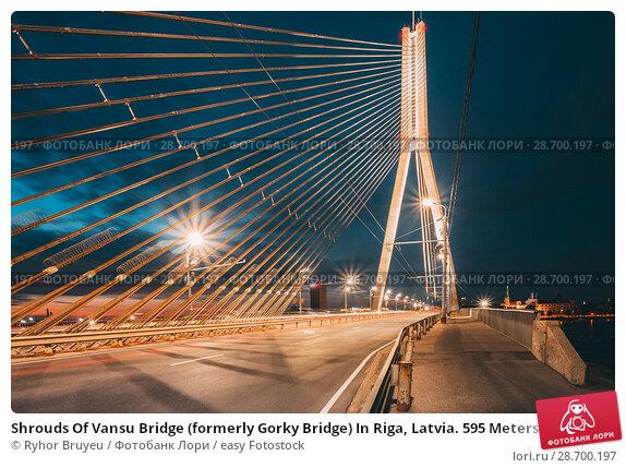 Купить «Shrouds Of Vansu Bridge (formerly Gorky Bridge) In Riga, Latvia. 595 Meters In Length. Vansu Bridge - One Of The Symbols Of Modern Riga. Cable-Stayed Bridge That Crosses The Daugava River.», фото № 28700197, снято 30 июня 2016 г. (c) easy Fotostock / Фотобанк Лори