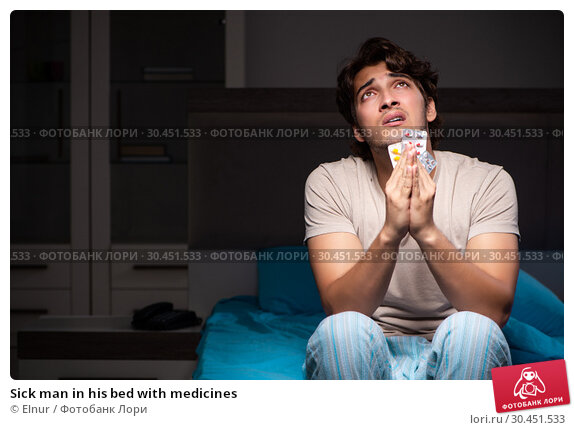Sick man in his bed with medicines. Стоковое фото, фотограф Elnur / Фотобанк Лори