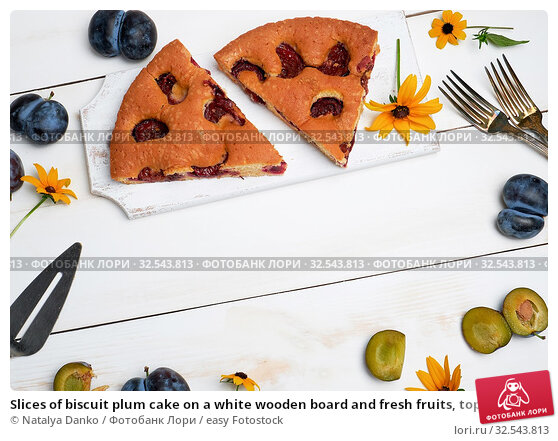 Купить «Slices of biscuit plum cake on a white wooden board and fresh fruits, top view.», фото № 32543813, снято 2 августа 2019 г. (c) easy Fotostock / Фотобанк Лори