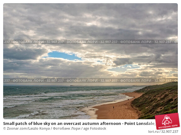 Small patch of blue sky on an overcast autumn afternoon - Point Lonsdale, Victoria, Australia. Стоковое фото, фотограф Zoonar.com/Laszlo Konya / age Fotostock / Фотобанк Лори