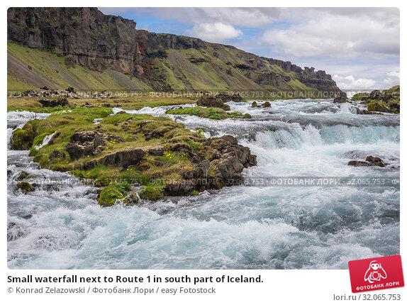 Small waterfall next to Route 1 in south part of Iceland. Стоковое фото, фотограф Konrad Zelazowski / easy Fotostock / Фотобанк Лори