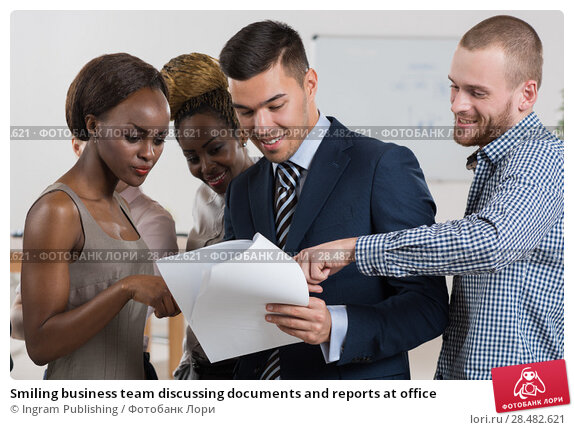 Купить «Smiling business team discussing documents and reports at office», фото № 28482621, снято 20 ноября 2014 г. (c) Ingram Publishing / Фотобанк Лори