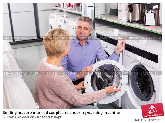 Купить «Smiling mature married couple are choosing washing machine», фото № 31994249, снято 20 ноября 2019 г. (c) Яков Филимонов / Фотобанк Лори