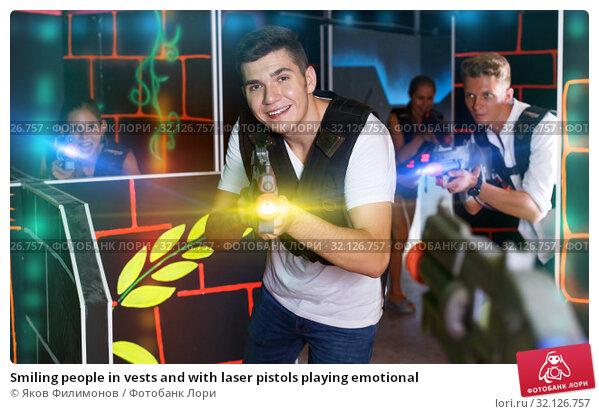 Купить «Smiling people in vests and with laser pistols playing emotional», фото № 32126757, снято 27 августа 2018 г. (c) Яков Филимонов / Фотобанк Лори