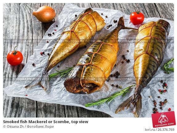 Купить «Smoked fish Mackerel or Scombe, top view», фото № 26376769, снято 2 февраля 2019 г. (c) Oksana Zh / Фотобанк Лори