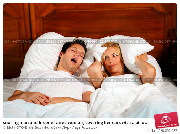 Купить «snoring man and his enervated woman, covering her ears with a pillow», фото № 20892037, снято 12 октября 2018 г. (c) age Fotostock / Фотобанк Лори
