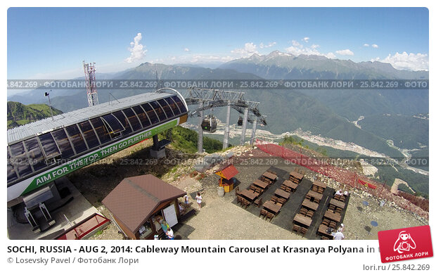 Купить «SOCHI, RUSSIA - AUG 2, 2014: Cableway Mountain Carousel at Krasnaya Polyana in the summer. It included in the list of Olympic facilities in Sochi 2014, aerial view», фото № 25842269, снято 2 августа 2014 г. (c) Losevsky Pavel / Фотобанк Лори