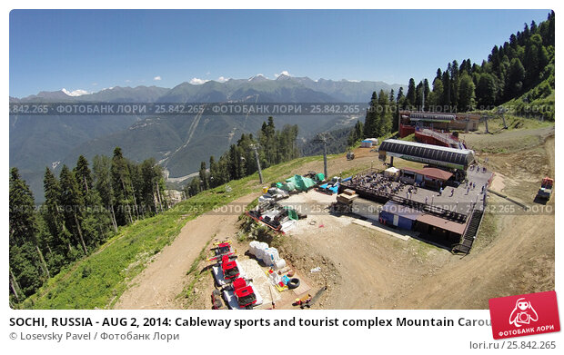 Купить «SOCHI, RUSSIA - AUG 2, 2014: Cableway sports and tourist complex Mountain Carousel at Krasnaya Polyana in the summer, aerial view. It included in the list of Olympic facilities in Sochi 2014», фото № 25842265, снято 2 августа 2014 г. (c) Losevsky Pavel / Фотобанк Лори