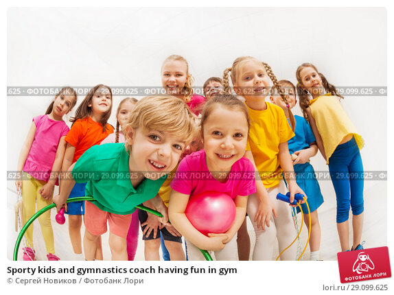 Купить «Sporty kids and gymnastics coach having fun in gym», фото № 29099625, снято 15 апреля 2017 г. (c) Сергей Новиков / Фотобанк Лори