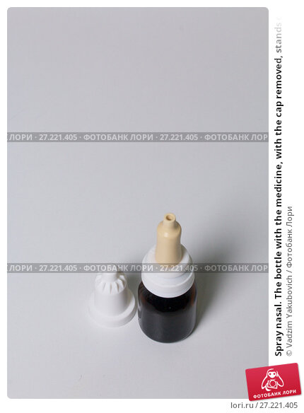 Купить «Spray nasal. The bottle with the medicine, with the cap removed, stands on the white surface of the table.», фото № 27221405, снято 14 ноября 2017 г. (c) Vadzim Yakubovich / Фотобанк Лори