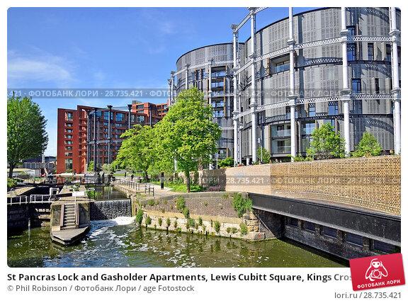 Купить «St Pancras Lock and Gasholder Apartments, Lewis Cubitt Square, Kings Cross, London, England, UK. Luxury flats built in Grade II listed gasholders.», фото № 28735421, снято 17 мая 2018 г. (c) age Fotostock / Фотобанк Лори