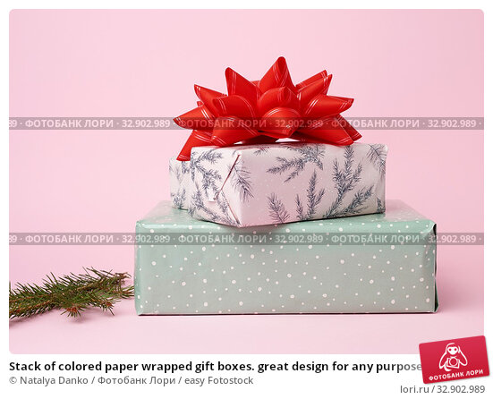 Stack of colored paper wrapped gift boxes. great design for any purposes. Стоковое фото, фотограф Natalya Danko / easy Fotostock / Фотобанк Лори