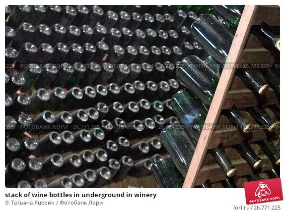 Купить «stack of wine bottles in underground in winery», фото № 26771225, снято 21 ноября 2017 г. (c) Татьяна Яцевич / Фотобанк Лори
