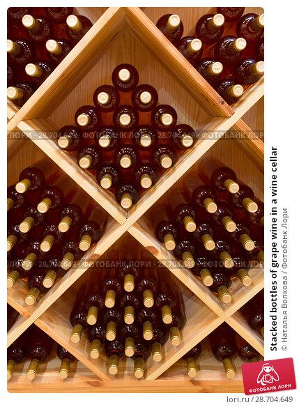 Купить «Stacked bottles of grape wine in a wine cellar», фото № 28704649, снято 9 июня 2018 г. (c) Наталья Волкова / Фотобанк Лори