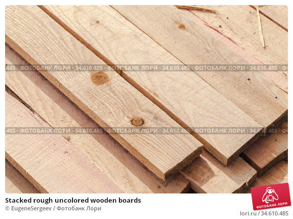 Stacked rough uncolored wooden boards. Стоковое фото, фотограф EugeneSergeev / Фотобанк Лори