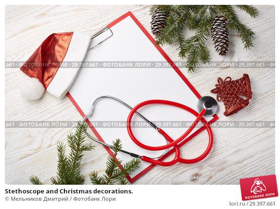 Купить «Stethoscope and Christmas decorations.», фото № 29397661, снято 4 ноября 2018 г. (c) Мельников Дмитрий / Фотобанк Лори