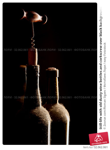 Still-life with old dusty wine bottles and corkscrew over black background. Стоковое фото, фотограф Zoonar.com/Roman Sigaev / easy Fotostock / Фотобанк Лори