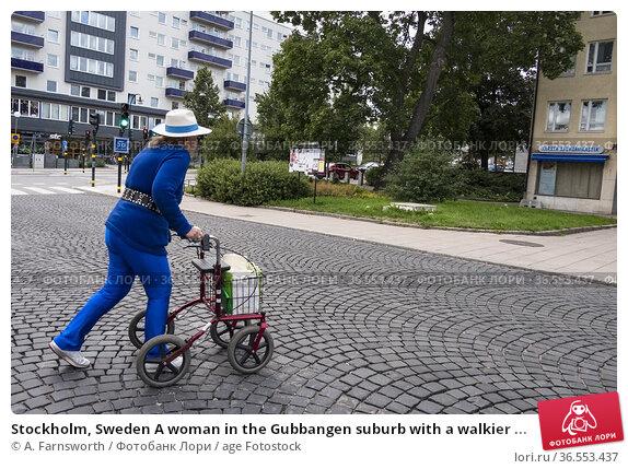 Stockholm, Sweden A woman in the Gubbangen suburb with a walkier ... Редакционное фото, фотограф A. Farnsworth / age Fotostock / Фотобанк Лори