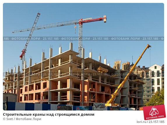 Купить «Строительные краны над строящимся домом», эксклюзивное фото № 23157185, снято 23 июня 2016 г. (c) Svet / Фотобанк Лори