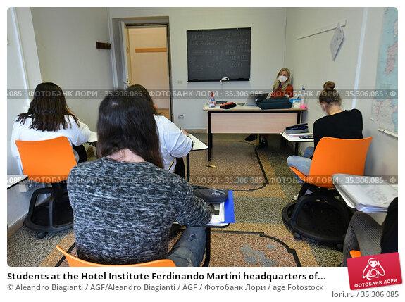 Students at the Hotel Institute Ferdinando Martini headquarters of... Редакционное фото, фотограф Aleandro Biagianti / AGF/Aleandro Biagianti / AGF / age Fotostock / Фотобанк Лори