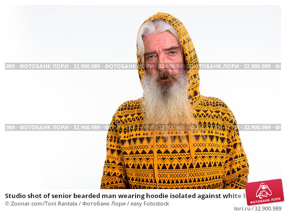 Studio shot of senior bearded man wearing hoodie isolated against white background. Стоковое фото, фотограф Zoonar.com/Toni Rantala / easy Fotostock / Фотобанк Лори